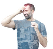 Double exposure of man with headache and cityview Royalty Free Stock Photography