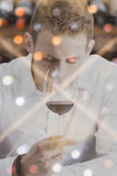Double exposure man smelling the wine and a wine rack Royalty Free Stock Image