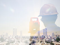 Double exposure man survey and civil engineer stand on ground working in a land building site over Blurred construction worker on Royalty Free Stock Photography