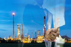 Double exposure man survey oil refiery plant, and chemical plant. In Thailand, oil tank, oil storage, and pipeline royalty free stock image