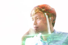 Double exposure man with waterfall in deep forest Stock Image