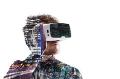 Double exposure. Man wearing virtual reality goggles. Night city stock image
