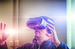Double exposure of man wearing virtual reality over the abstract blurred background. Double exposure of man wearing virtual reality over the abstract photo Royalty Free Stock Photo