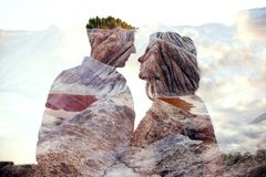 Double exposure man and woman couple hugging with mountains in background. Mountains inside couple in love. Lovers look at each stock images