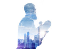 Double exposure of megalopolis and bearded guy with longboard Royalty Free Stock Photography