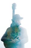 Double exposure of a melancholic musician with a casual hat   Stock Photo