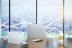 Double exposure with modern desk and business charts Royalty Free Stock Photos