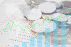 Double exposure of money coins with growing graph. Double exposure of money coins with growing graph, Blurred world map background, Finance and banking concept Stock Images