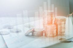 Double exposure of Money coins stack, book bank, graph  finance. Finance concept Stock Photo
