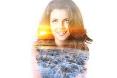 Double exposure nature. Portrait of beautiful young woman and sunset sea. Royalty Free Stock Images