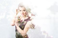 Double exposure nature. Portrait woman, tree and flowers. Royalty Free Stock Photography