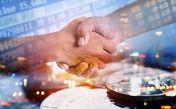 Free Double Exposure Of Hand Shaking With City And Coins For Finance Stock Photo - 121465010