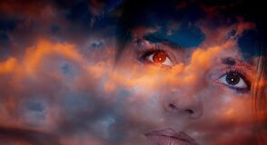 Double Exposure Of Woman Face And Dark Sunset Sky Royalty Free Stock Photography