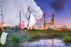 Double exposure of oil and gas refinery plant at twilight Royalty Free Stock Image