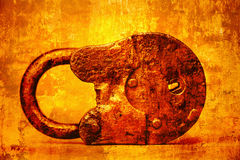 Double exposure of an old padlock and yellow abstract bright orange background Stock Photos
