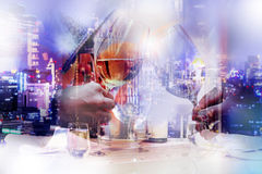 Double exposure of party time in the city. Double exposure of party time and the night time city in blue tone Royalty Free Stock Images