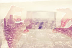 Double exposure of people with smart phone and cityscape Royalty Free Stock Photography