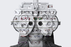 Double exposure phoropter and exhibitor of glasses. Double exposure of a eyesight measurement to a woman with a phoropter and an exhibitor of glasses Royalty Free Stock Photos