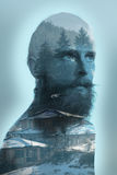Double exposure photo on bearded hipter and mountain stock photos