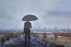 Double exposure photo of business man with umbrella Royalty Free Stock Photo