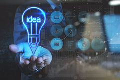 double exposure photo of businessman hand draws lightbulb with n stock photos