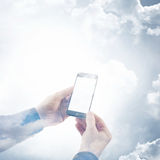 Double exposure photo businessman holding modern smartphone hands. Reflection of clouds background, white blank screen Royalty Free Stock Photos