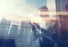 Double exposure photo man touching screen smartphone.Picture bearded trader manager in modern loft.Contemporary city Royalty Free Stock Images