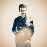 Double exposure of photographer looking at camera. Royalty Free Stock Image