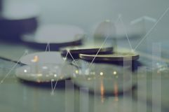 Double exposure pile of coins and night city, concept in growth, save, finance, account,capital banking  and investment. Double exposure pile of coins and night Royalty Free Stock Images