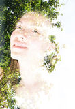 Double exposure portrait. Of attractivу woman combined with photograph of a tree Stock Images