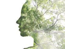 Double exposure portrait. Of attractive lady combined with photograph of tree. Be creative Royalty Free Stock Photo