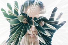 Double exposure portrait. Of attractive woman in black gloves forming glasses combined with photograph of cactus Stock Photos