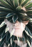 Double exposure portrait. Of attractive woman covering her face with hair combined with photograph of cactus Stock Image