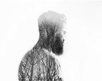 Double exposure portrait of a bearded guy Royalty Free Stock Photography
