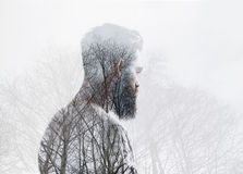 Double exposure portrait of a bearded man and tree Stock Photo