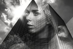 Double exposure portrait of beautiful blonde woman merged with urban city Stock Photography