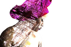 Double exposure portrait. Of beautiful latin girl mixed with image of panoramic wheel. Beauty concept Stock Photo