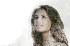 Double exposure portrait of beautiful young woman combined with. Double exposure portrait of beautiful young woman woman combined with photograph of green Stock Images