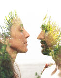 Double exposure portrait. Of a couple combined with photograph of greenery royalty free stock image