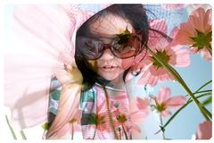 Double exposure portrait of little cute girl with flower background Royalty Free Stock Photography