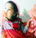 Double exposure portrait of little cute girl with roses background Royalty Free Stock Photos