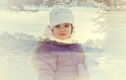 Double exposure portrait of a little girl and snowy winter landscape stock photography