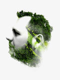 Double exposure portrait of man combined with branches. Royalty Free Stock Photos