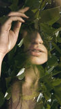 Double exposure portrait. Of sensual woman combined with photograph some leaves Stock Photo