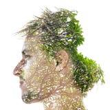 Double exposure portrait. Surreal double exposure portrait. Environmental concept Stock Photography