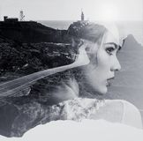 Double exposure. Woman and nature. Double exposure. Portrait of woman combined with a mountain road and the sea. Black and white photo Royalty Free Stock Photography