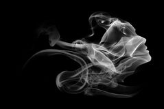 Double exposure portrait of woman and smoke. Royalty Free Stock Photo