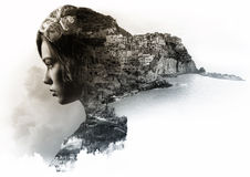 Double exposure portrait. Of a woman and view of Manarola. La Spezia, Liguria, northern Italy. Toned image Royalty Free Stock Image