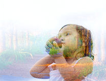 Double exposure portrait of a young girl Royalty Free Stock Image