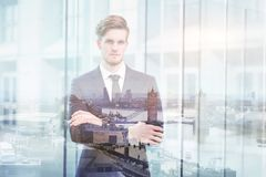 Double exposure portrait of young successful business man stock photo